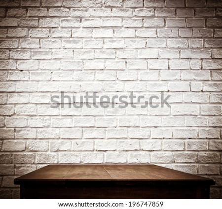 Filter - white brick wall and wooden table - stock photo