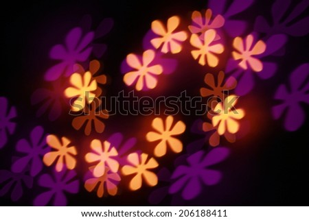 Filtered Flowers bokeh blurred background. - stock photo