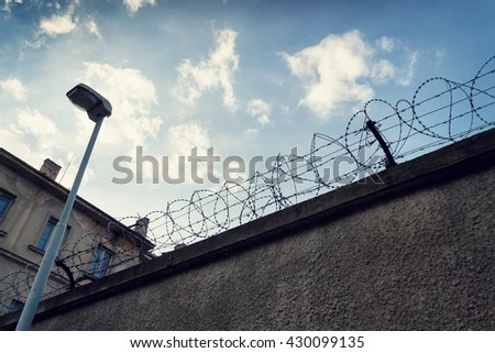 Filtered vintage picture of barbed wire prison fence detail  - stock photo