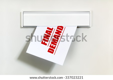 Final demand notice on letter being delivered through a letterbox concept for unpaid bill, late payment and repayment financial worry - stock photo