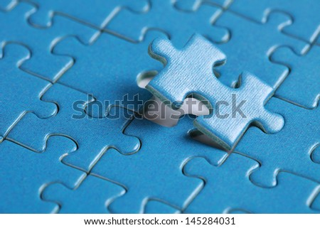 Final piece of jigsaw problem solution topic - stock photo