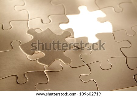 Final piece of jigsaw puzzle - stock photo