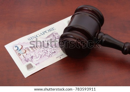 Finance and legal system concept, Singapore money and wooden gavel on  table