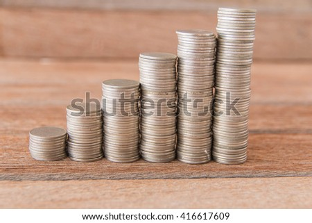 Finance and Money concept, Money coin stack growing graph with sunlight