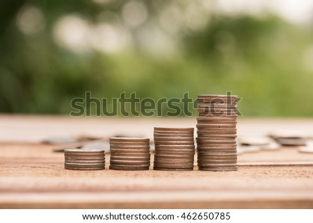 Finance and Money concept, Money coin stack growing graph with sunlight,investment