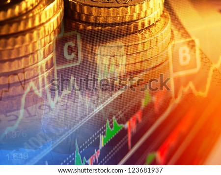 Finance background with graph and coins.