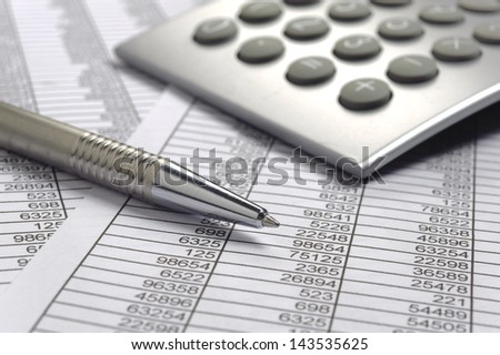 finance calculation with tables and calculator - stock photo