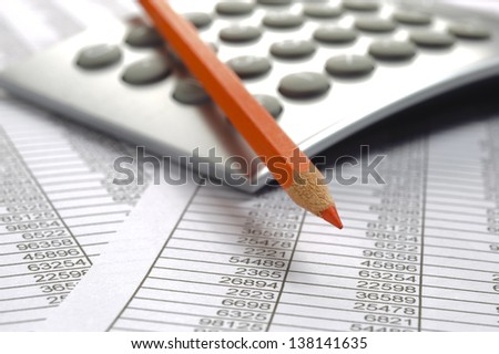 finance calculator and red pencil on business calculation