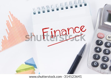Finance concept - Financial accounting stock market graphs analysis. Calculator, notebook with blank sheet of paper, pen on chart. Top view - stock photo