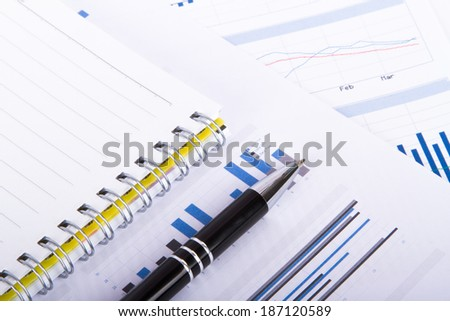 Finance concept, financial and stock market graphs, charts analysis on business table.
