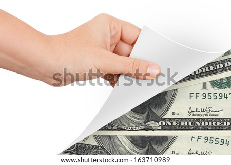 Finance concept, one hundred dollar banknotes behind paper, hand turning page. - stock photo