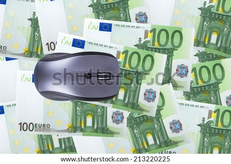 Finance concept, one hundred euro banknotes under computer mouse. - stock photo