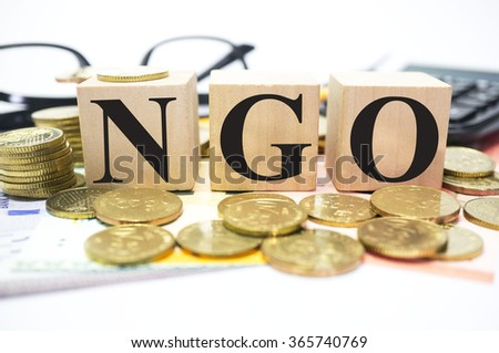 Finance Concept with Stack of Coins, NGO or Non-governmental organization written