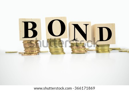 Finance Concept with Stack of Coins, with bond written