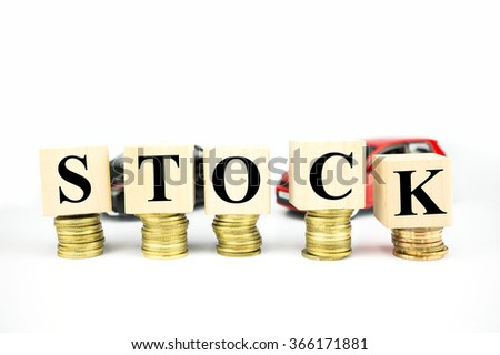 Finance Concept with Stack of Coins, with stock written - stock photo