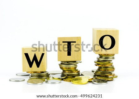 Finance Concept with Stack of Coins - WTO (World Trade Organization) written on.