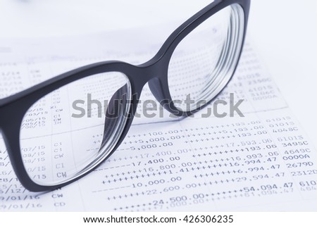 Finance Concepts, glasses with passbook as background