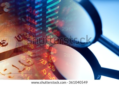 Finance data and magnifying glass. Macro image. - stock photo