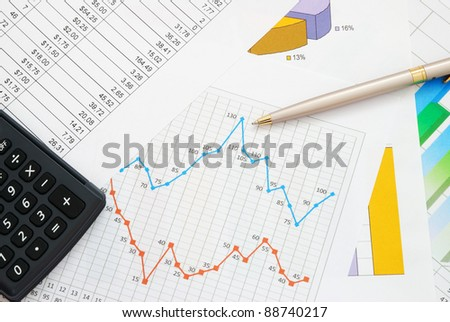 Finance documents with pen and calculator - stock photo