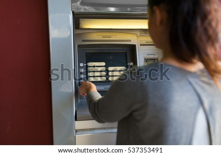 finance, money, bank and people concept - close up of woman choosing option on atm machine