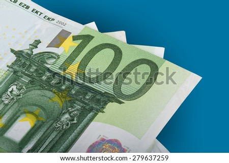 Finance money concept, detailed close up view of  one hundred euro, isolated on blue background. - stock photo
