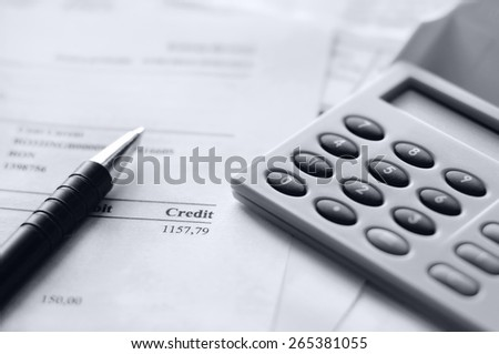 finance stats, bill with calculator - stock photo