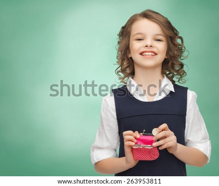 finances, childhood, people, money and savings concept - happy little girl with purse and euro coin over over green chalk board background - stock photo