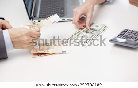 finances, currency, exchange rate, technology and people concept - close up of hands counting dollar and euro money at office - stock photo