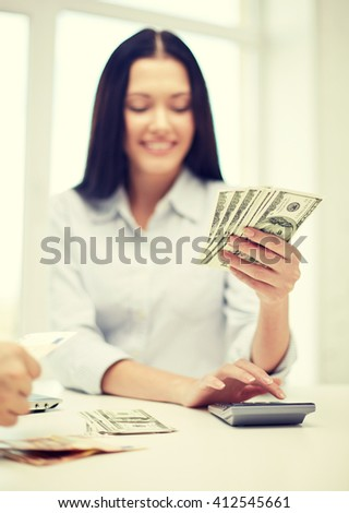 finances, currency, exchange rate, technology and people concept - close up of happy woman counting dollar money with calculator - stock photo