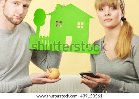 Finances management home family savings concept. Worried couple examining their bills. Young man and woman counting expenses together. - stock photo