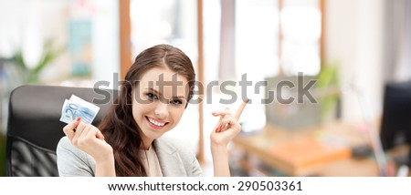 finances, people, savings and investment concept - happy business woman with euro cash money over office room background - stock photo