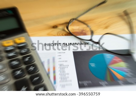 Financial accounting of profit summary graphs analysis, digital effect zoom lense for background - stock photo