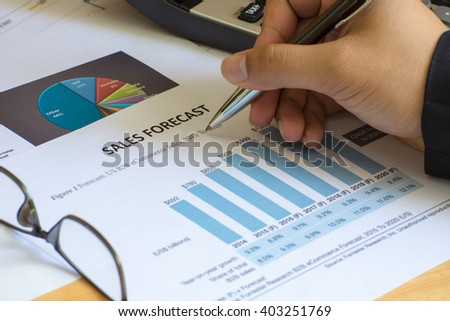 Financial accounting sales forecast graphs analysis with hand writing