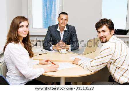 Financial adviser and his customers - stock photo