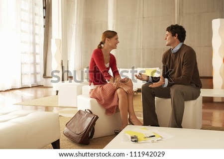 Financial adviser explaining the investment plans to woman - stock photo