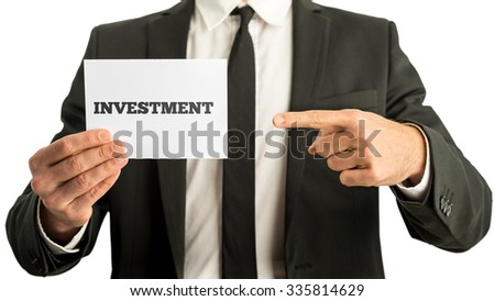 Financial adviser holding up a white card with Investment sign. Conceptual of finance, stock market and business investment. - stock photo