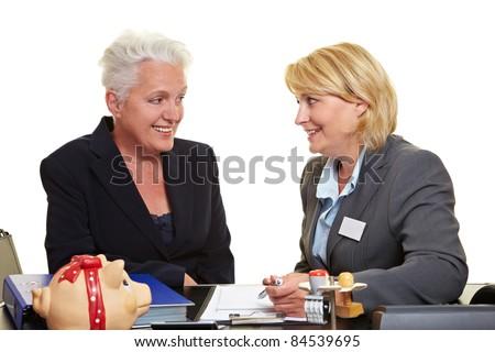Financial adviser offering senior woman investment plan - stock photo