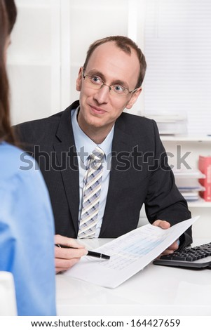 Financial adviser sales an insurance. - stock photo