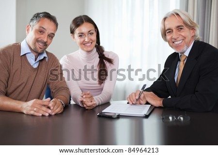 Financial advisor in meeting with a young couple - stock photo