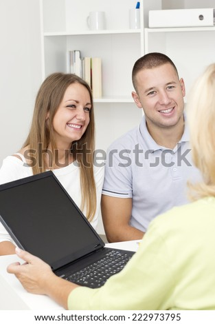 Financial  Advisor with customers.  - stock photo