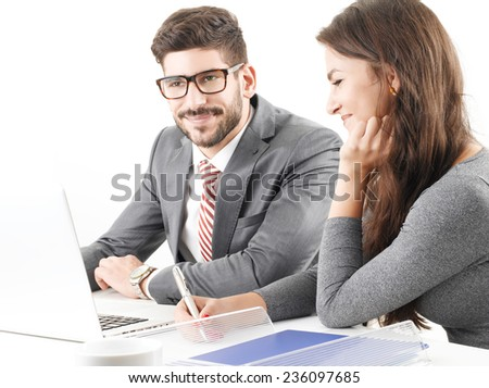 Financial advisor working at laptop with business woman. Isolated on white background.