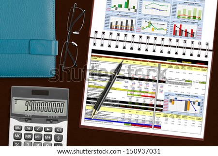 financial analysis & statistic book with stationery on the desk