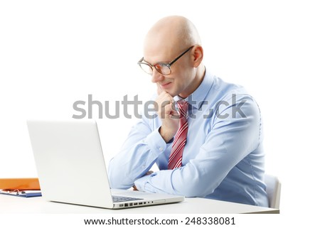 Financial analyst working at laptop while sitting at desk. Isolated on white background.  - stock photo