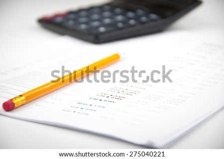Financial analyzing letter witn calculator and yellow pencil  - stock photo