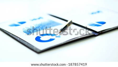 financial and business color charts and graphs on the table - stock photo