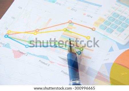 financial and business color charts and graphs on the table.business concept