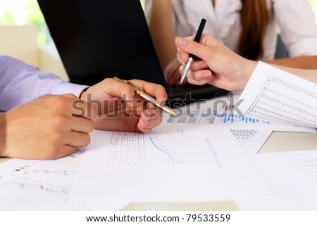 financial and business documents on the table and human hands - stock photo