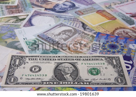 Financial background - Assortment of banknote (Focus on the Dollar) - stock photo