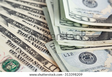 Financial background. Closeup of few ten and twenty USA dollar bank notes