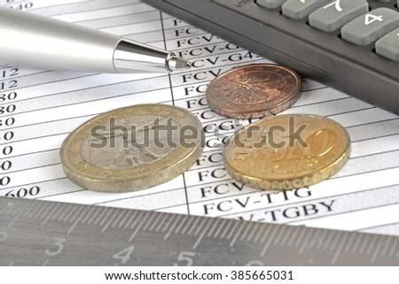 Financial background with money, calculator, ruler, graph and pen.